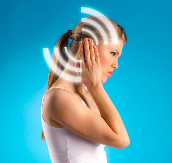 Waves of tinnitus pictured over a model's ear.