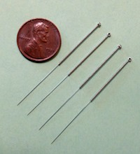 Image of one inch filiform needles.