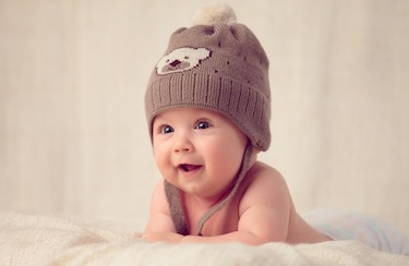 An infant wearing a hat.