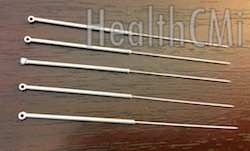 Five stainless steel needles with wound handles depicted.