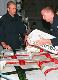 US Navy is depicted seizing illegal cocaine shipment.